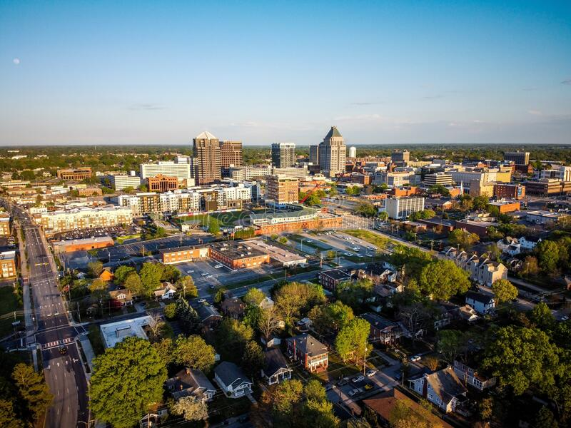 Skyline of the city of Greensboro under a blue sky in North Carolina. The skyline of the city of Greensboro under a blue sky in North Carolina royalty free stock photography