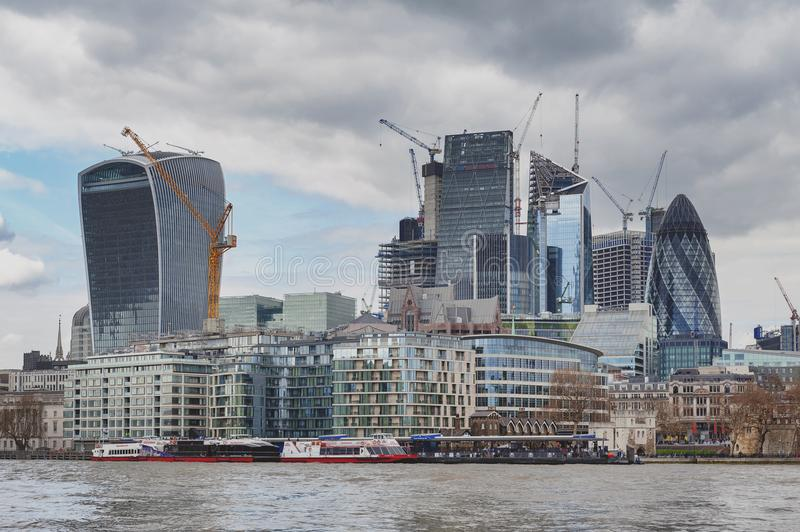 Skyline of the city of London by the River Thames with skyscrapers and buildings constructed in modern architectural style royalty free stock image