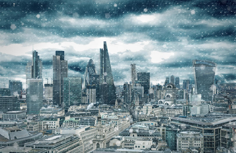 The skyline of the City of London with a snow blizzard in winter, United Kingdom. The skyline of the City of London with a snow blizzard in winter stock photo