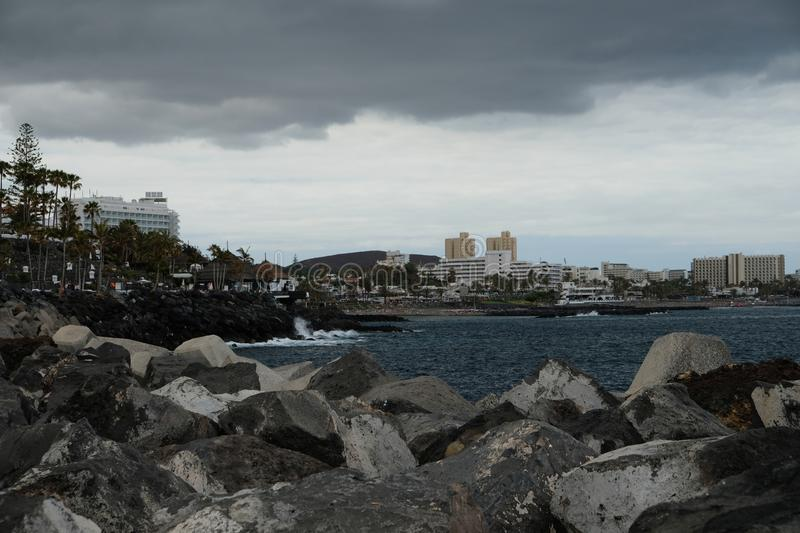 Skyline and cloudy evening over shore royalty free stock image