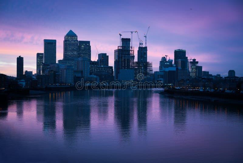 Skyline at dawn, London, Canary Wharf. Skyline at dawn with reflection, London, Canary Wharf royalty free stock image