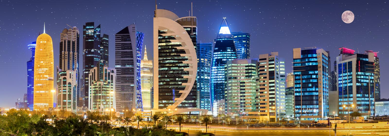 The skyline of Doha with full moon and stars. The skyline of Doha, Qatar, by night with full moon and stars stock images