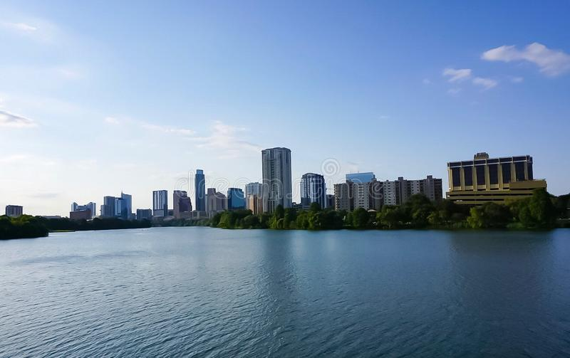 The skyline of downtown Austin Texas from the boardwalk on Lady Bird Lake. A look at the city skyline of downtown Austin Texas from the boardwalk on Lady Bird royalty free stock photos