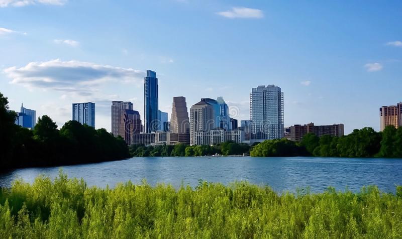 The skyline of downtown Austin Texas from the boardwalk on Lady Bird Lake stock image