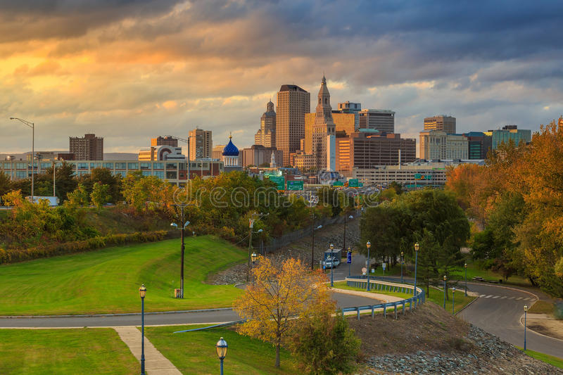 Skyline of downtown Hartford, Connecticut from above Charter Oak. Landing at sunset stock images