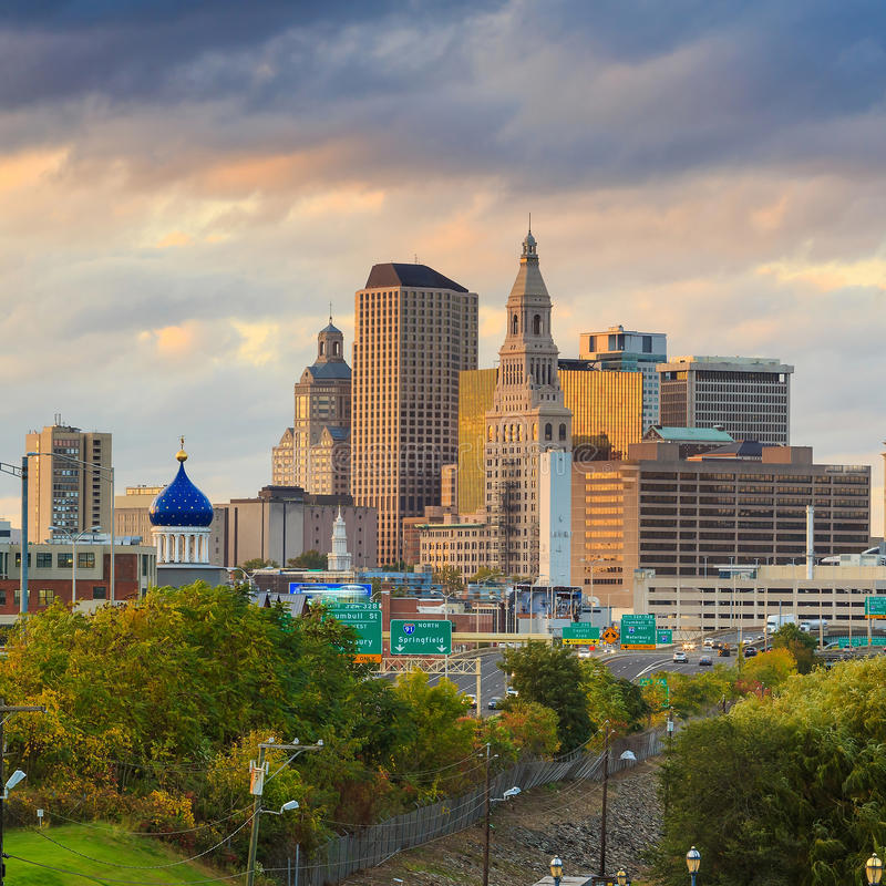 Skyline of downtown Hartford, Connecticut from above Charter Oak. Landing at sunset royalty free stock photos