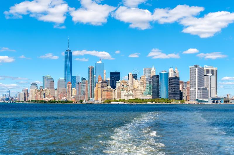 The skyline of downtown Manhattan on a sunny summer day. The skyline of downtown Manhattan seen from the New York Harbor royalty free stock photo
