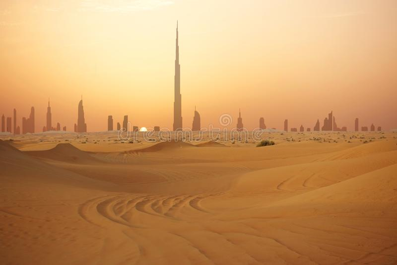 Skyline of Dubai at sunset or dusk, view from Arabian Desert royalty free stock photos