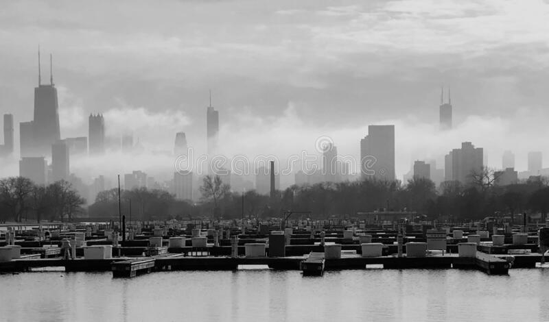 Skyline in Ground Fog In Noir. This is a winter picture in Noir of ground fog moving the the Chicago skyline from Diversey Harbor located in Chicago, Illinois in royalty free stock photography