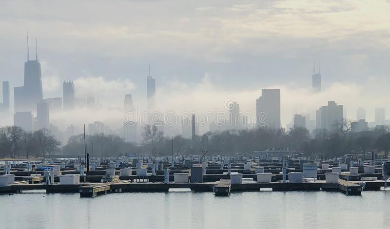 Skyline in Ground Fog #1. This is a winter picture of ground fog moving through the Chicago skyline from Diversey Harbor located in a Chicago, Illinois in Cook royalty free stock photos