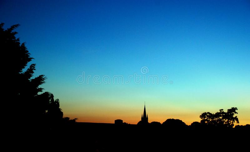 Skyline of Hilversum the netherlands. Sunset skyline of Hilversum the netherlands. Orange, blue skies stock photos