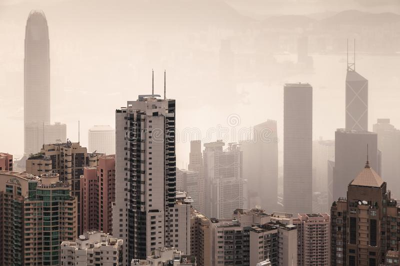 Skyline of Hong Kong city in foggy day stock photos