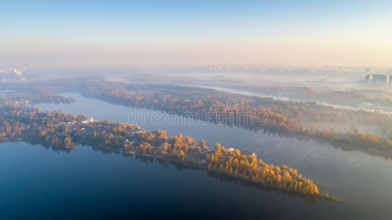 Skyline, Kiev city with beautiful morning sky. Pedestrian bridge. Left bank the Dnieper River. Aerial view. Sunrise over city stock photo