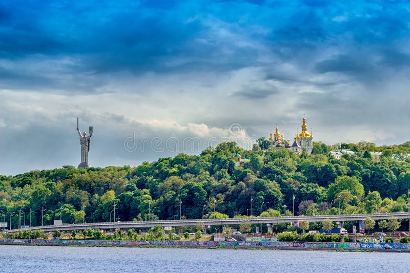Kyiv landscape on Dnipro river. Skyline, Kiev city in the evening. Left bank the Dnieper River royalty free stock photo