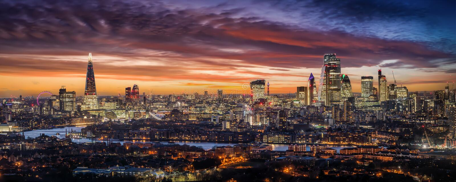 The skyline of London, United Kingdom, during an intense sunset. Elevated, panoramic view to the beautiful illuminated urban skyline of London, United Kingdom stock photo