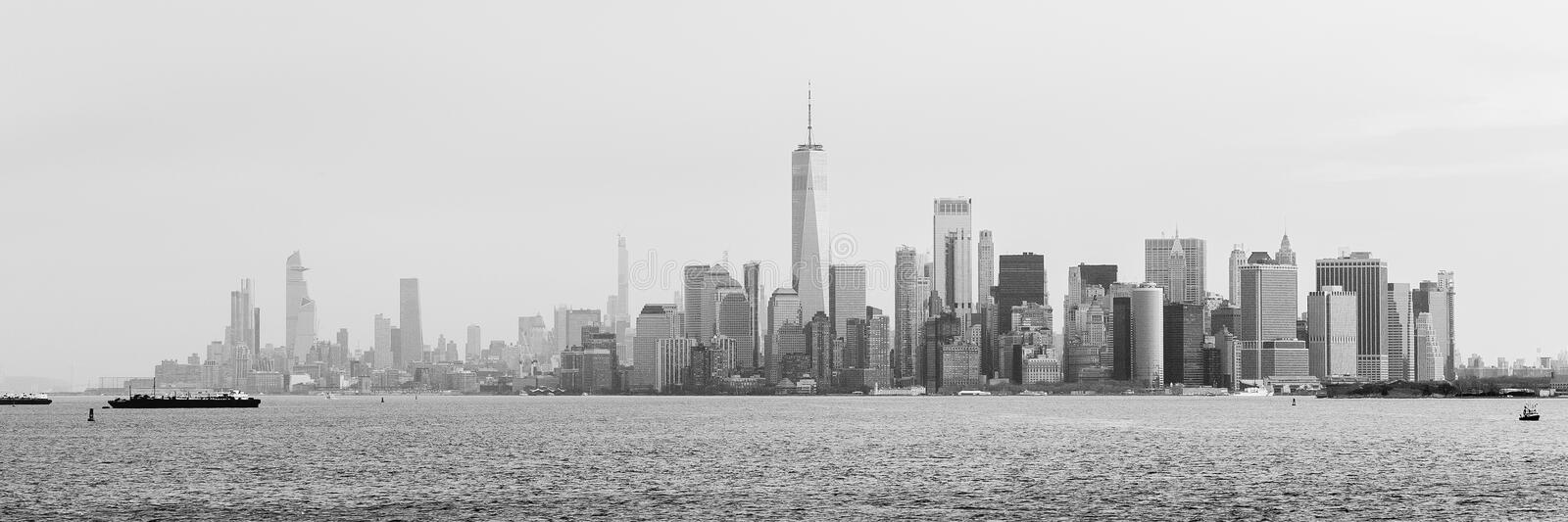 Skyline of lower Manhattan of New York City. From ferry boat. Black and white panoramic view. March 2020 stock image