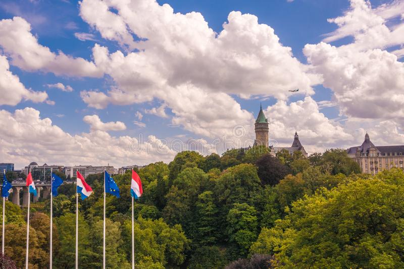 Skyline of Luxembourg City. Castle surrounded by trees in a cloudy day