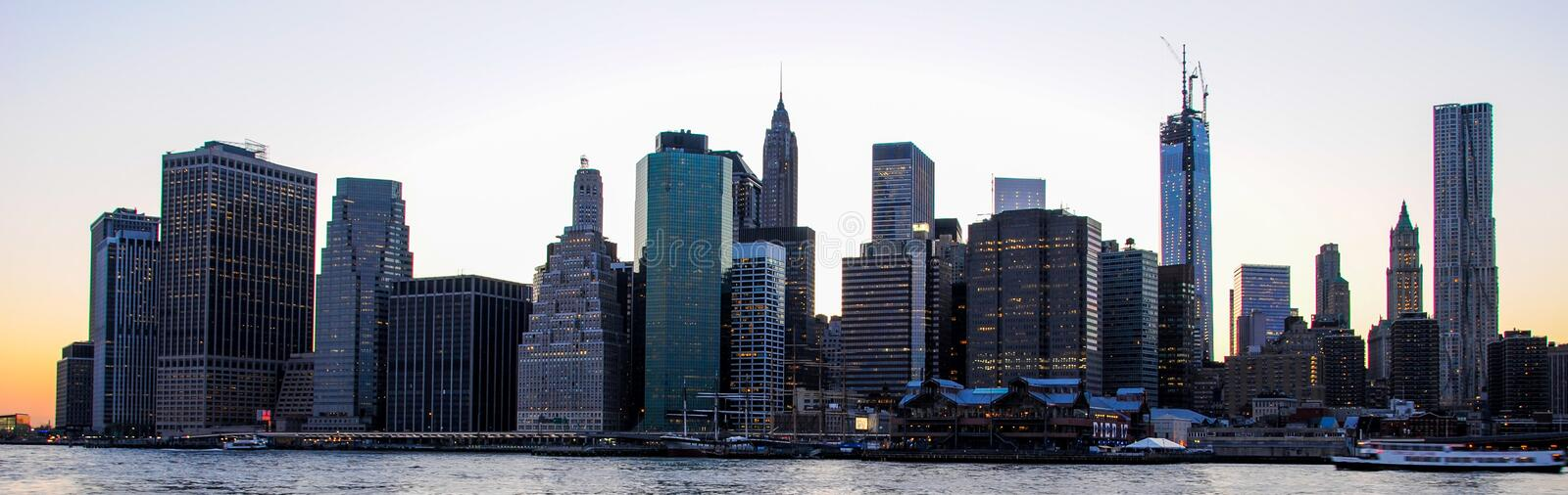 Skyline of Manhattan at sunset, closed to night. Nice view since Brooklyn stock image