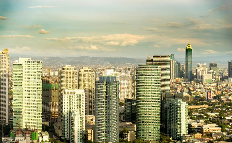 Skyline of Manila. MANILA, PHILIPPINES - CIRCA MARCH 2018: View on the skyline of Makati as clouds pass through the blue sky circa March, 2018 in Manila stock images