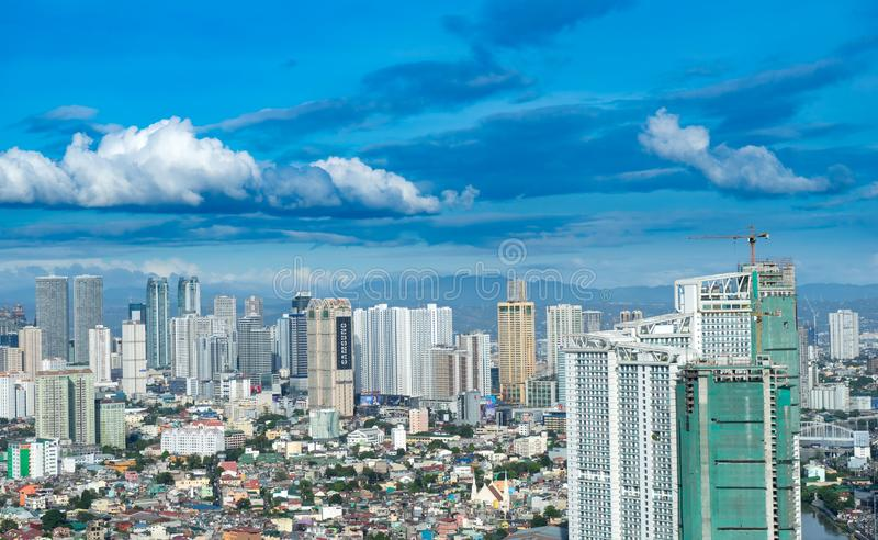 Skyline of Manila. MANILA, PHILIPPINES - CIRCA MARCH 2018: View on the skyline of Makati as clouds pass through the blue sky circa March, 2018 in Manila stock photo