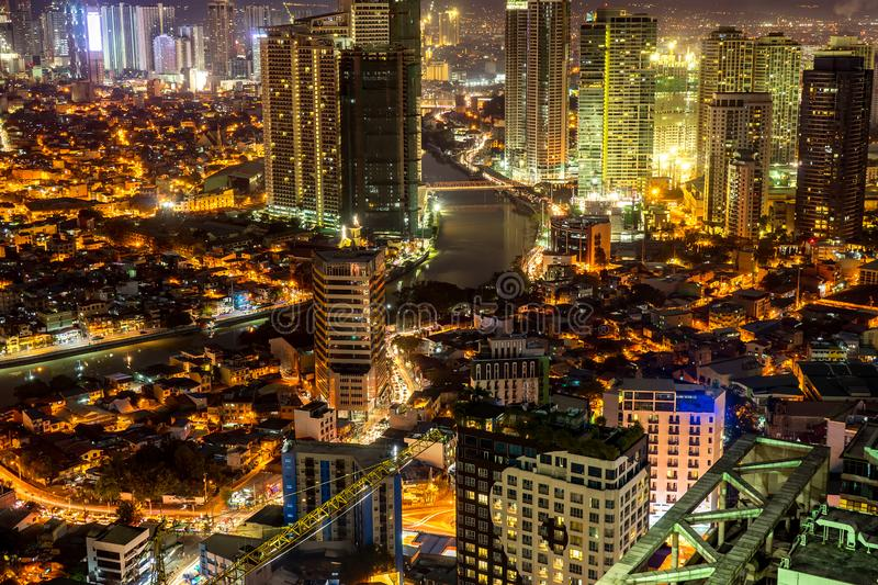 Skyline of Manila by the River Pasig. View on the Skyline of Makati at night in Manila, Philippines royalty free stock photos