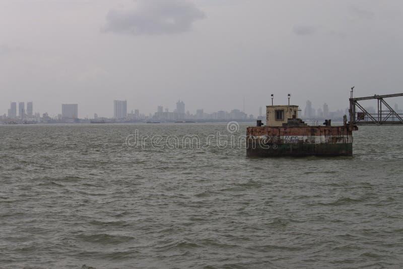 Skyline of megalopolis Mumbai. With port facilities, India stock image