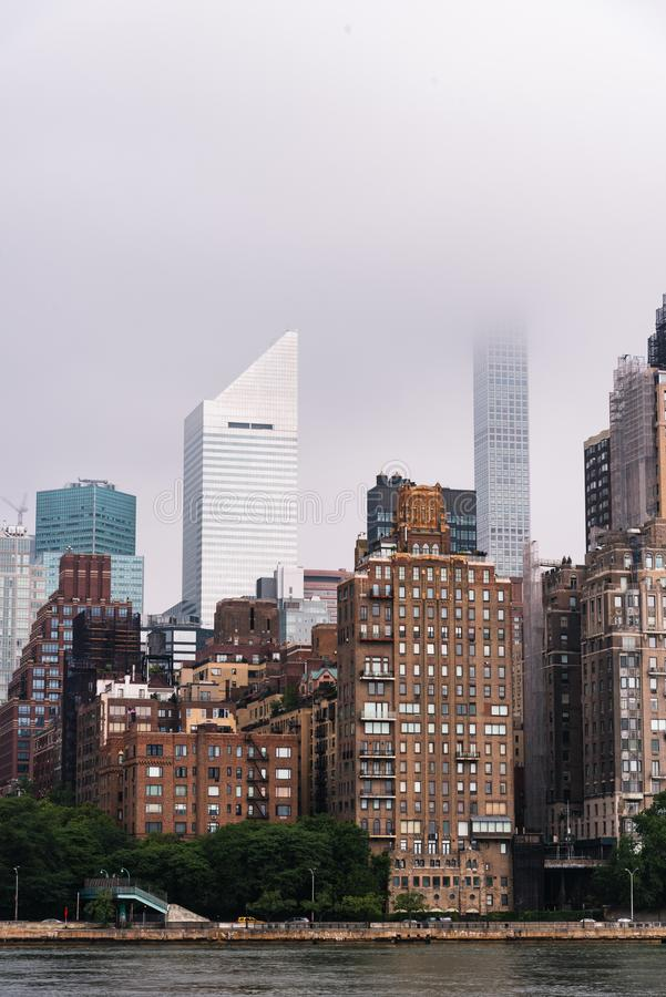 Skyline of Midtown of New York City. Skyline of Midtown of NYC from East River in Roosvelt Island a misty day royalty free stock images