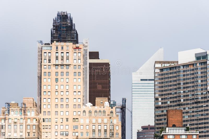 Skyline of Midtown of New York City. Skyline of Midtown of NYC from East River in Roosvelt Island a misty day royalty free stock image