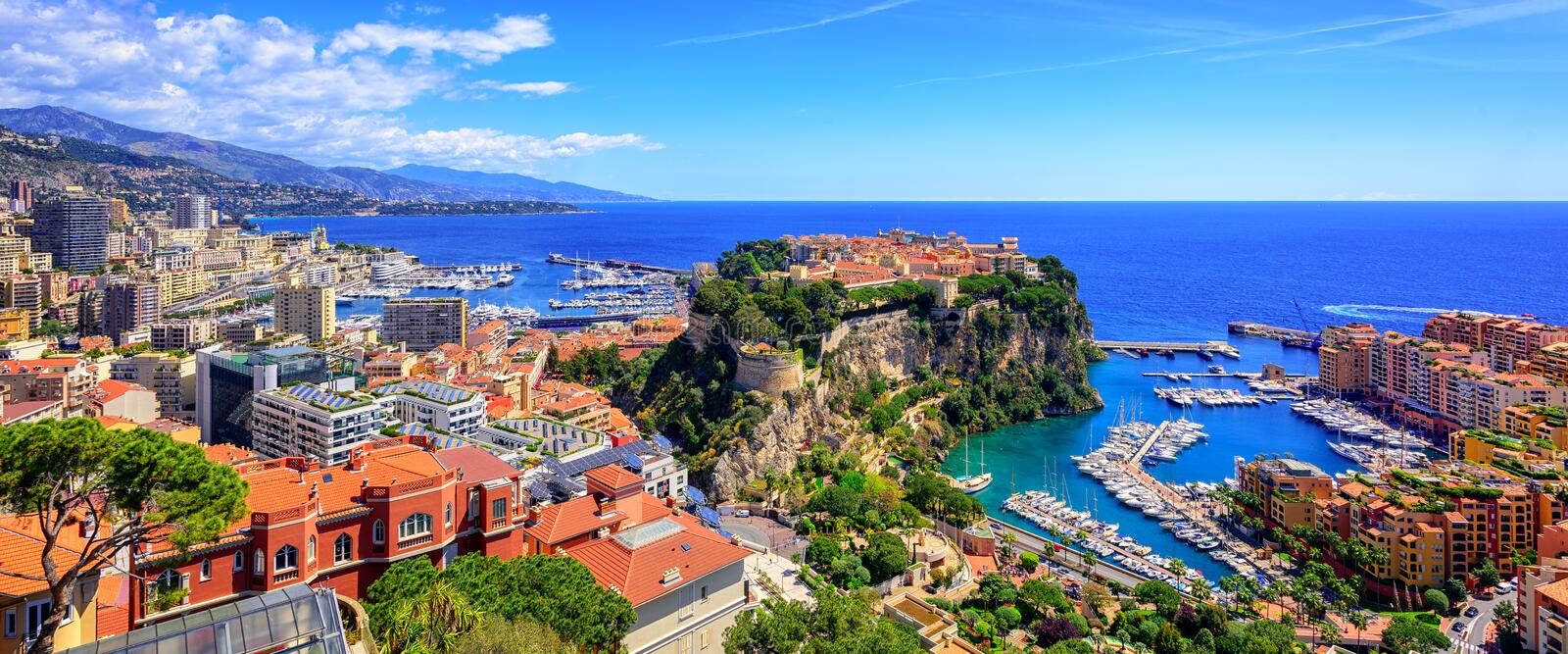 Skyline of Monaco with Prince Palace, old town and port. Panoramic view of Monaco and Monte Carlo with the od town, port and Prince's Palace royalty free stock photo