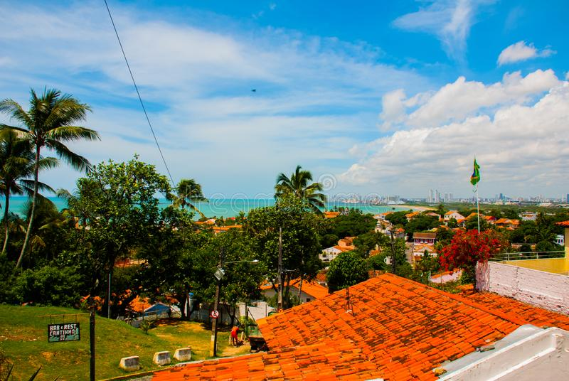The skyline of Olinda and Recife in Pernambuco, Brazil contrasting the historic buildings of Olinda dated from the 17th century royalty free stock photos