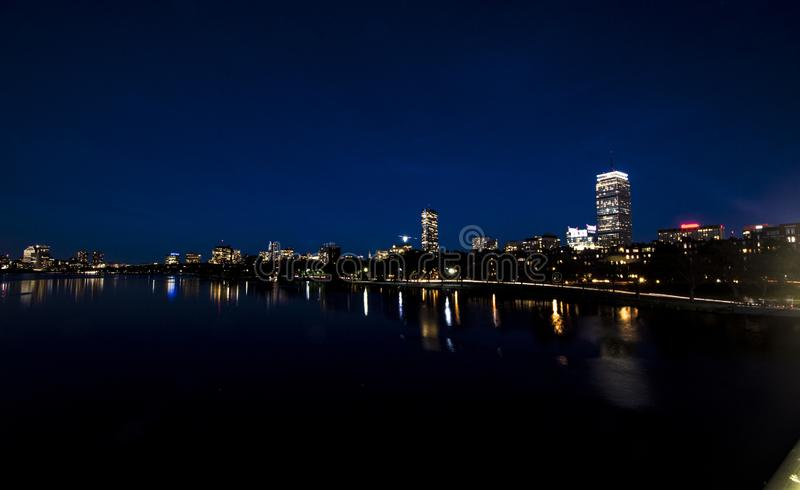 Night view of the skyline of Boston city reflected in the Charles river royalty free stock photo