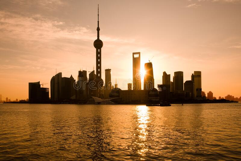 Skyline of Pudong and Lujiazui at sunrise across the Huangpu river, Shanghai stock image