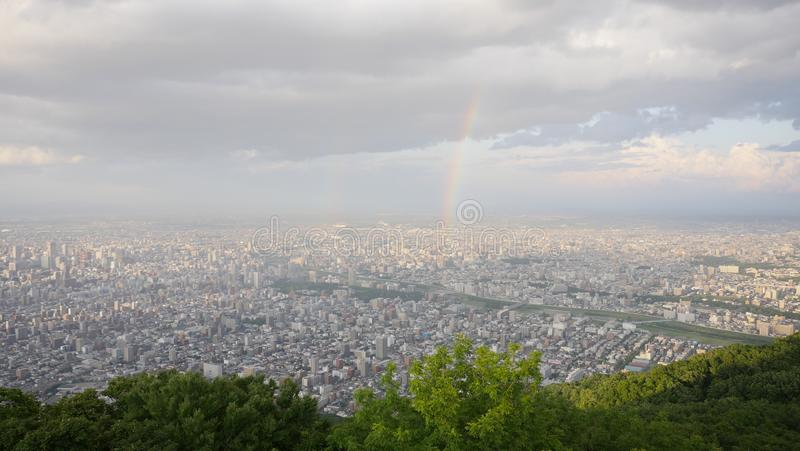 Skyline, rainbow, lover locks and satelite from top of mountain Moiwa, Hokkaido, Japan stock images
