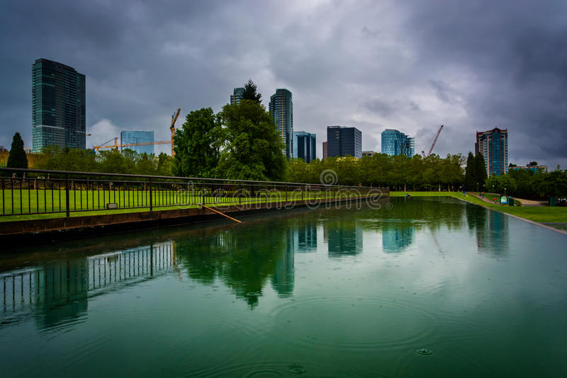 The skyline reflecting in a pond, at Downtown Park, in Bellevue, Washington. royalty free stock photography
