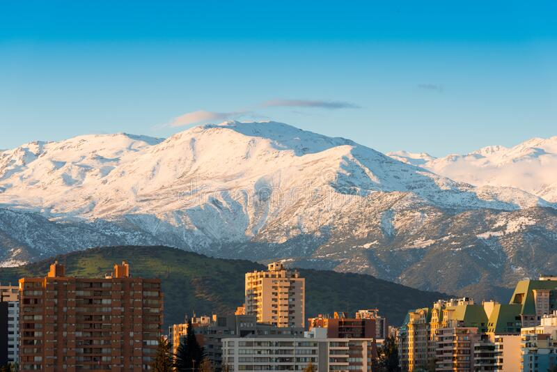 Skyline of Residential apartment buildings at Las Condes district with snowed Los Andes Mountain Range in the back, Santiago stock photo