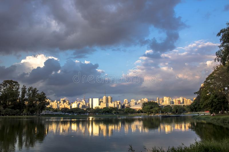 Skyline of Sao Paulo. City and reflex in lake stock images