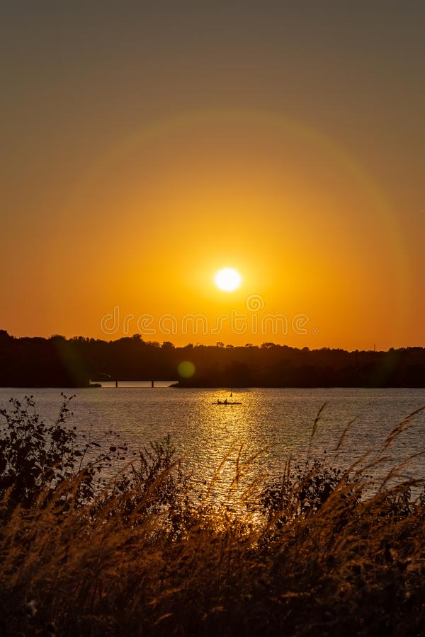 Halo around Clear outline of the setting sun at Sunset with beautiful skyline over lake Zorinsky Omaha Nebraska. Skyline of the setting sun with beautiful royalty free stock photo