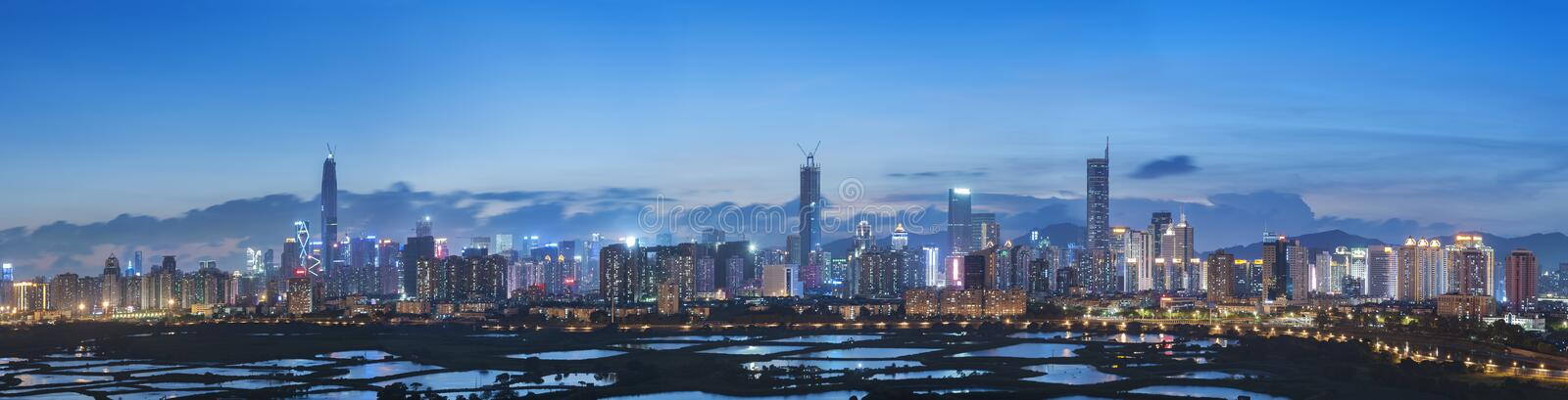 Skyline of Shenzhen City, China at twilight. Viewed from Hong Ko stock image