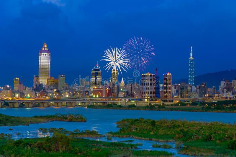 Skyline of Taipei city under dramatic sky. Skyline of Taipei city with firework stock image