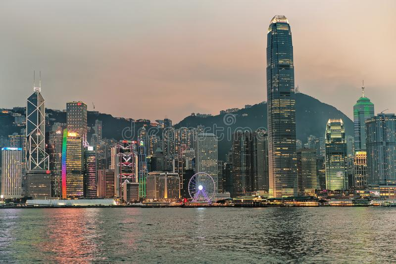 Skyline and Victoria Harbor in Hong Kong evening stock images