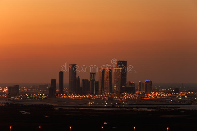 A skyline view of Abu Dhabi, UAE at dusk, looking towards Reem Island stock photography