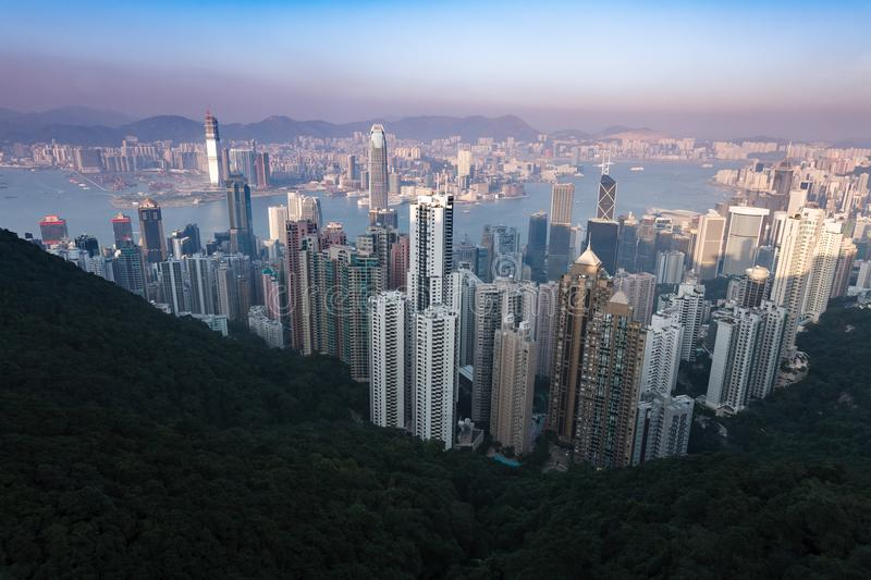 Skyline view of Hong Kong Harbor with glow of pink sunset. Skyline view of Hong Kong Harbor at sunset stock photos