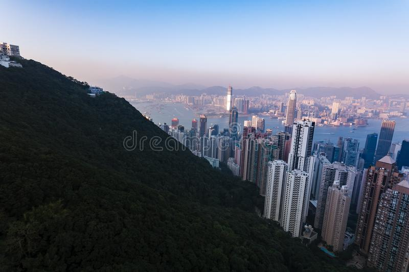 Skyline view of Hong Kong Harbor at sunset. From mountain top royalty free stock images
