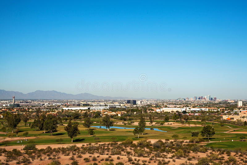 Skyline View of Phoenix and Golf Course. Beautiful overhead view of the city of Phoenix, Arizona, USA with a golf course in the foreground and downtown buildings royalty free stock photography