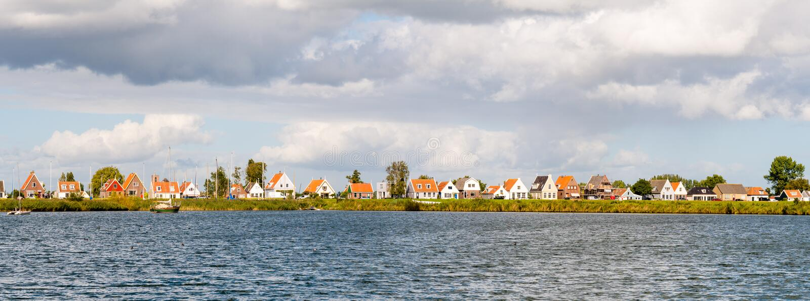 Skyline of village Durgerdam with old houses and boats, IJm stock photography