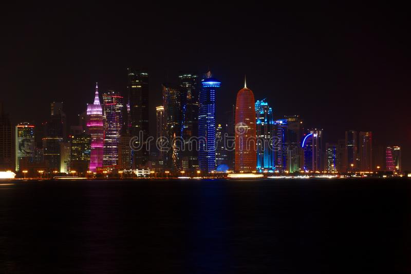 Skyline of West Bay skyscrapers, at night from the Corniche. Doha, Qatar. royalty free stock photos