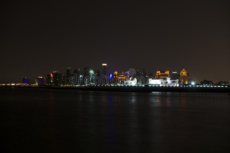Skyline of West Bay, at night from the Pearl. Doha, Qatar. royalty free stock image