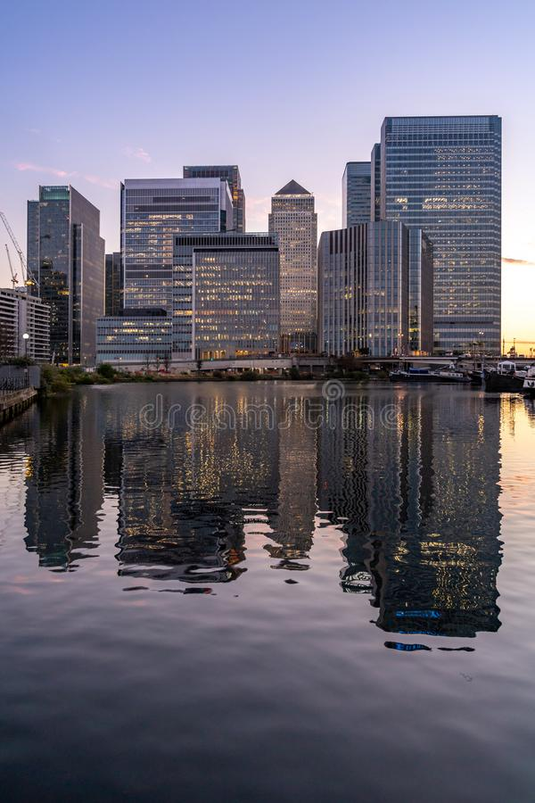 Canary Wharf in London UK sunset twilight stock images
