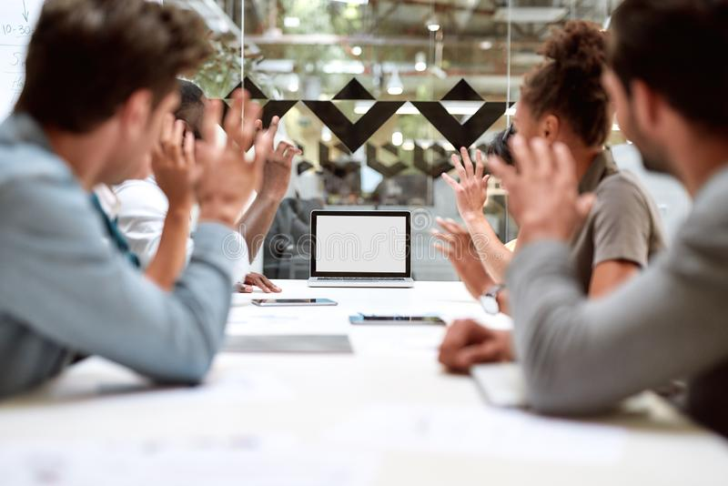 Skype call. Group of business people having video conference while sitting in meeting room. Business team looking at the. Screen of laptop. Technology concept royalty free stock photo