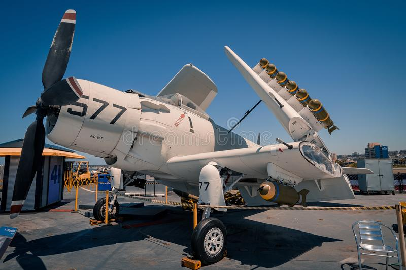 A-1 Skyraider attack prop plane on board Uss Midway aircraft carrier museum at the San Diego Harbor California clear summer day. The USS midway is a retired royalty free stock photo